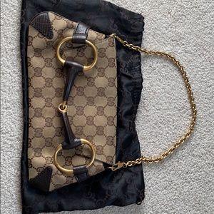 Authentic Gucci horse bit clutch